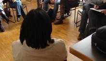 Photo of university group sitting around discussing